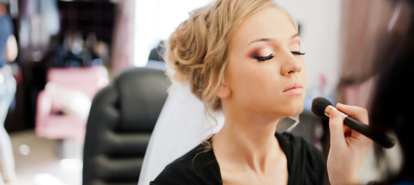 applying wedding make-up by make-up artist